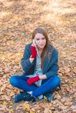 Young woman chatting on her mobile Royalty Free Stock Photo