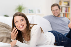 Young woman chatting on a mobile Royalty Free Stock Photos