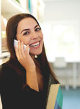 Young woman chatting on a smart phone Stock Photography