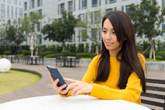 Young woman check of the mobile phone Royalty Free Stock Photo