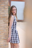 Young woman in checked dress Royalty Free Stock Photography