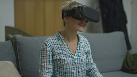 Cheerful woman in VR headset stock footage