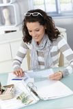 Young woman checking bills Stock Image