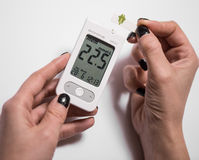 Young woman checking blood sugar level Stock Image