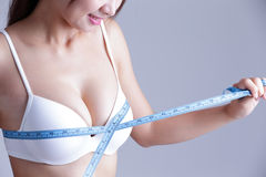 Young woman checking breast measurement Royalty Free Stock Photo