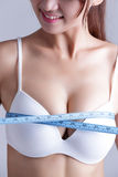 Young woman checking breast measurement Stock Image