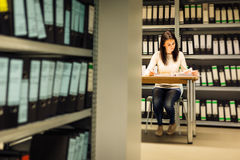 Young Woman Checking Documents In The Archives Stock Photography