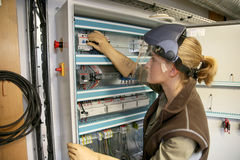 Young woman checking electrical instalations Royalty Free Stock Photo