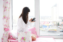 Young woman checking email and social networking accounts Stock Photography