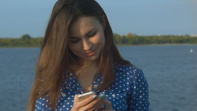 Young woman checking her messages stock footage