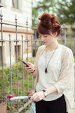 Young woman checking her mobile phone Stock Photos