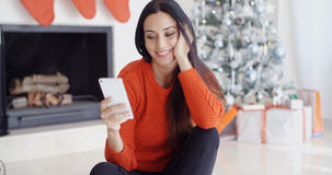 Young woman checking out her text messages Stock Photo