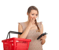 Young woman checking purchases list Royalty Free Stock Image