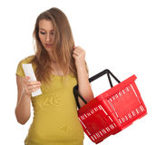 Young woman  checking purchases list Stock Image