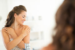 Young woman checking skin condition Royalty Free Stock Photo