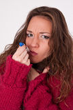 Young woman checking temperature with thermometer Stock Photography