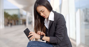 Young woman checking the time with a frown Royalty Free Stock Photo