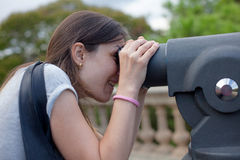 Young woman checking view of Barcelona with binoculars Stock Images