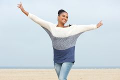 Young woman with cheerful expression and arms outstretched Royalty Free Stock Photo