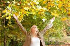 Young woman cheering. Beautiful young blond woman cheering royalty free stock image