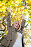 Young woman cheering. Beautiful young blond woman cheering royalty free stock images