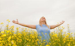 Young woman cheering. In the field stock photo