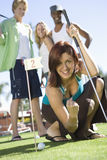 Young Woman Cheering While Playing Golf Royalty Free Stock Photos