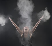 Woman dancing in white powder Royalty Free Stock Photos