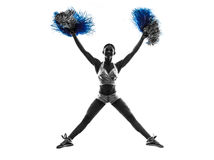 Young woman cheerleader cheerleading  silhouette. One young woman cheerleader cheerleading  silhouette studio on white background Royalty Free Stock Photos