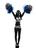 Young woman cheerleader cheerleading  silhouette Royalty Free Stock Photos