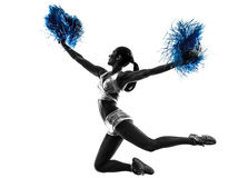 Young woman cheerleader cheerleading  silhouette. One young woman cheerleader cheerleading silhouette studio on white background Royalty Free Stock Images