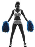 Young woman cheerleader cheerleading  silhouette Stock Images