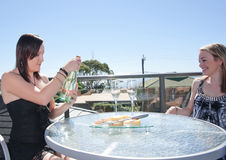 Young woman with cheese and champagne Royalty Free Stock Photography