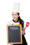 Young woman Chef with blackboard menu. Portrait of beauty woman Chef hold a blackboard menu royalty free stock image