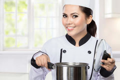 Young woman Chef cooking Stock Images