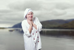 Young woman chef has neck pain. she is suffer.  Royalty Free Stock Photos