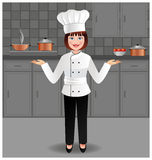 Young woman chef in her kitchen Royalty Free Stock Image