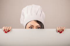 Young woman chef holding a blank white sign Royalty Free Stock Photo