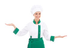 Young woman chef holding, showing or presenting something isolat Royalty Free Stock Image