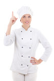 Young woman chef pointing finger up isolated on white Stock Photo