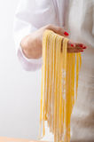 Young woman chef prepares homemade pasta Royalty Free Stock Photos