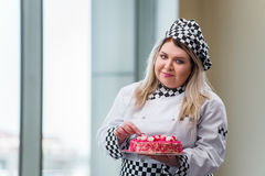 The young woman chef preparing dessert cak Stock Photo