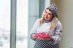 The young woman chef preparing dessert cak Stock Photo