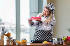 The young woman chef preparing dessert cak Royalty Free Stock Image