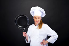 Young woman chef with tools on dark background Royalty Free Stock Photography