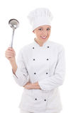 Young woman in chef uniform with big metal spoon isolated on whi Royalty Free Stock Photos