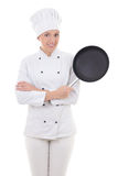 Young woman in chef uniform with frying pan isolated on white Royalty Free Stock Images
