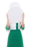Young woman chef in uniform holding big tray behind her face iso Stock Photos