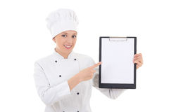 Young woman in chef uniform holding clipboard with blank paper i Royalty Free Stock Photography