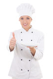 Young woman chef in uniform holding empty plate and thumbs up is Royalty Free Stock Photography